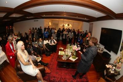 Lawrence addresses the gathering of the home of Joumana Kayrouz