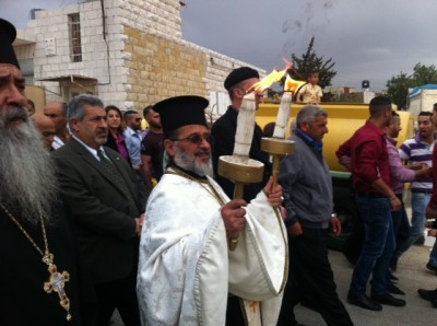 Shown in photo Fr. Daoud Philip Khoury receiving Holy Fire in Taybeh. (photo credit:  Buthina Canaan Khoury)