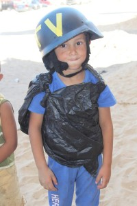 """Young boy in Gaza pretending to be a journalist with his home made flak jacket, had to lend him my helmet."" - JoMa Sommarstrom, Foreign News Journalist, Swedish Broadcasting, Sveriges Radio  https://twitter.com/ekmathia"