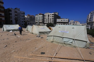 UNRWA officials detail urgent needs of 55,000 Palestinian civilians in the Gaza Strip displaced by Israeli war crimes during the July-August 2014 war. (Photo (C) Copyright 2014 Mohammed Asad and may be used with full attribution to Mohammed Asad and The Arab Daily News.)