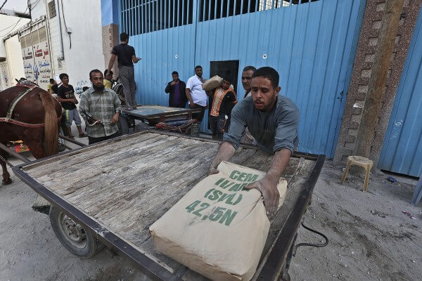 Cement and supplies trickle in to rebuild Gaza