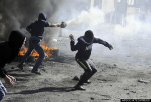 Palestinians throw rocks and shoot fireworks during clashes with Israeli border police, as Israeli police limit the access to Al-Aqsa mosque in Jerusalem on Friday, Nov. 7, 2014. (AP Photo/Mahmoud Illean)