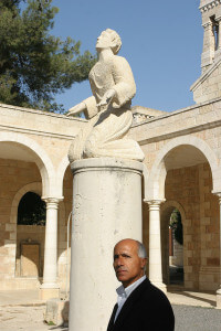 """Vanunu in the courtyard of St. Stephens Church, because when we crossed paths in 2007 in front of the east Jerusalem church, Vanunu quipped, """"This is the very spot where the first Christian was martyred for freedom of speech."""" Photo Copyright Meir Vanunu"""