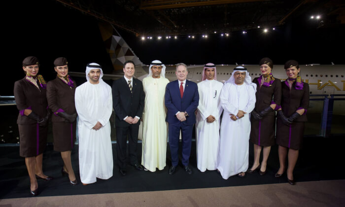 (Left to right all Etihad Airways) Hareb Al Muhairy, VP UAE; Peter Baumgartner, Chief Commercial Officer; Abdul Qader Hussein Ahmed, VP Government and International Affairs; James Hogan, President and Chief Executive Officer; Khaled Al Mehairbi, SVP Government and Aeropolitical Affairs; Hasan Al Hammadi, SVP Executive Affairs; with members of the airline's cabin crew, in front of Etihad Airways' first A380. (PRNewsFoto/Etihad Airways)