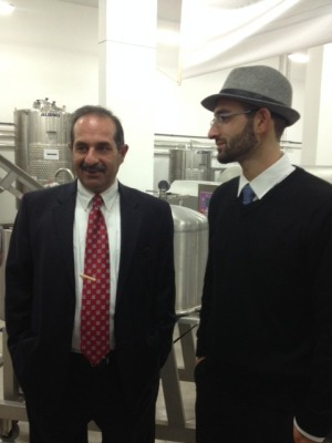 Nadim Khoury , co founder of Taybeh Brewing Company and Taybeh Winery with  his son Canaan the new wine maker of Palestine. Copyright 2014 Maria Khoury All Rights Reserved