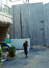 Eileen Fleming on the Bethlehem side of Israel's Wall, Copyright Meir Vanunu