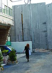 Eileen Fleming on the Bethlehem side of Israel's Wall, Copyright Meir Vanunu
