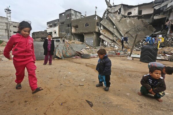 Gaza children continue to play in rubble of buildings destroyed by Israeli rocket fire as Israel blocks funding and aid. Photo Copyright (C) 2015 Mohammed Asad. All Rights Reserved. Permission to republish given with full credit to Mohammed Asad and The Arab Daily News.