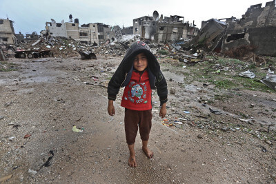 Shoeless boy in Gaza, devastated by Israeli bombing and rocket fire. Photo (C) 2015 Mohammed Asad All Rights Reserved. Permission to reprint with full attribution to Mohammed Asad and The Arab Daily News.