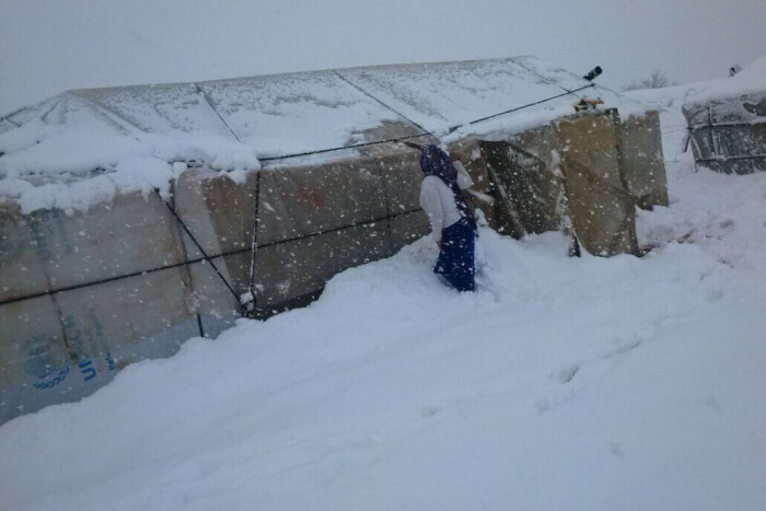 "January 7, 2015 in Bekaa valley Lebanon.   Heavy snowfall in Lebanon January 7, 2015. Yesterday staff from NRC Lebanon's Bekaa office were working with refugees to put in place flood mitigation measures in advance of the forecast harsh storm which hit overnight. Field teams distributed 1,205 plywood sheets and 885 bricks as floor-raising kits for tents in two settlements in the town of Sarain, and 250 wooden pallets to ensure a clear pathway in five settlements in the town at risk of flooding.  Niamh Murnaghan, NRC's Country Director in Lebanon said, ""This morning residents of these informal settlements awoke to a knee-deep blanket of snow. With roads impassable in Bekaa, our staff have not been able to reach refugee settlements, but refugees have sent photos of themselves clearing the snow from their tents."" Photo credit: NRC Lebanon/Syrian refugees in Lebanon."