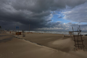 Storm clouds gather over the Gaza coastal region. Photo Copyright (C) 2015 Mohammed Asad. All Rights Reserved. Permission to republish given with full credit to Mohammed Asad and The Arab Daily News.