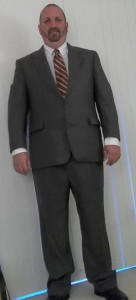 Craig Stephen Hicks in a grey suit at Christmas time