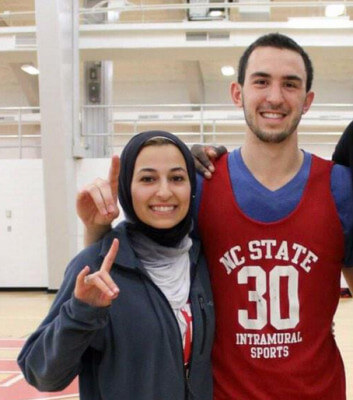 Deah Shaddy Barakat and his wife Yusor at a recent UNC Basketball game. (From Barakat's Facebook Page)