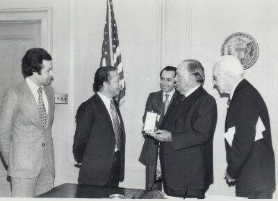 The Ambassador of Morocco (2nd from left) greets Chicago Mayor Richard J. Daley (2nd from right) at his City Hall office to receive a commemoration honoring the special relationship between America and Morocco. Picture center is Baker Lemseffer who was the director of the CHicago office of the Morocco Cultural Center. On the right is Col. Jack Reilly and on the left is a Moroccan aid who accompanied the Ambassador. The story was the main story in a 1976 issue of The Middle Eastern Voice Newspaper published by Ray Hanania in Chicagoland. Photo (C) Copyright 1976-2017 Ray Hanania. All Rights Reserved