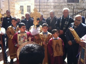 Children carry Icons of the Orthodox Church at services in Taybeh, Palestine March 1, 2015