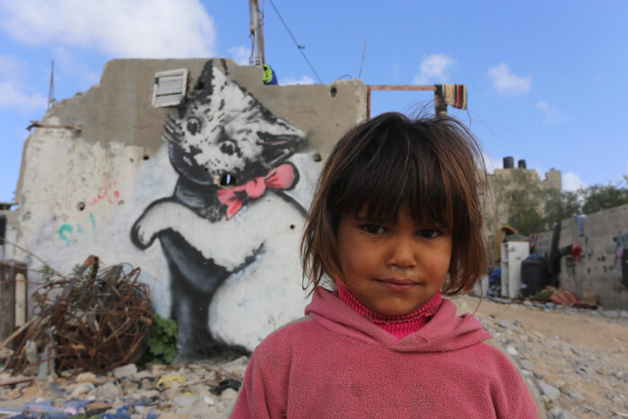 Murals painted by British artist Banksy. Copyright 2015 Mohammed Asad All Rights Reserved. Permission to reprint with full attribution to Mohammed Asad and The Arab Daily News