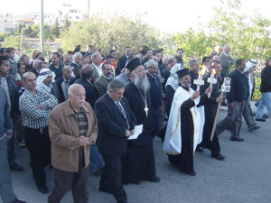Miracle of the holy Fire. Fr. Daoud P. Khoury receiving Holy Fire Taybeh Ecumenical Procession last year with altar boys and scouts