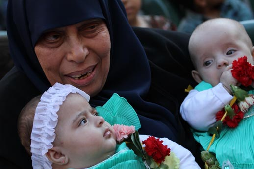 Palestinians celebrate babies born of fathers being held in Israel's gulag detention centers during protests of abuses by Israeli guards. (C) 2015 by Mohammed Asad. All Rights Reserved. Permission granted to republish with credit to Mohammed Asad and The Arab Daily News.