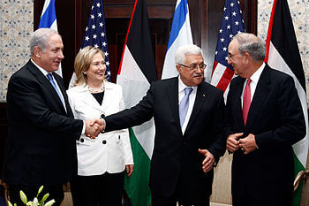 Israeli Prime Minister Benjamin Netanyahu (first from left), U.S. Secretary of State Hillary Rodham Clinton (second from left), Palestinian President Mahmoud Abbas (third from left), and U.S. Special Envoy for Middle East Peace George C. Mitchell (fourth from left) chat after their meeting in Sharm El Sheikh, Egypt, on September 14, 2010. Department photo/ Public Domain (Photo credit: Wikipedia)
