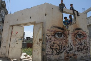 Eyes painted on destroyed homes in the Gaza Strip. Copyright (c) 2015 Mohammed Asad. All Rights Reserved. Permission to republish given with full credit to Mohammed Asad and The Arab Daily News.