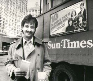 Ray Hanania covering Chicago City Hall (1976-1992) In front of the Page 10 Banners on the Sun-Times Trucks, 1985