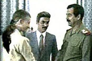 April Glaspie shakes hands with Saddam Hussein