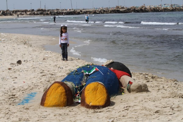 Children in the Gaza Strip build a small memorial to Aylan Kurdi near the beach as a show of solidarity. Children need protection everywhere including from Israeli assaults
