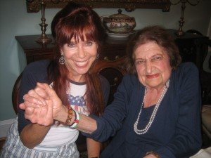 Helen Thomas sporting her Palestinian flag bracelet and one of the saints with Eileen Fleming. Photo by Rich Forer, 2011