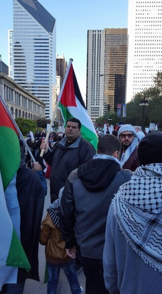 Palestinians and protestors proudly waved Palestinian flags at the protest in Chicago Sunday Oct. 18, 2015 against Israel's occupation. Photo courtesy of Dr. Atiyeh Salem