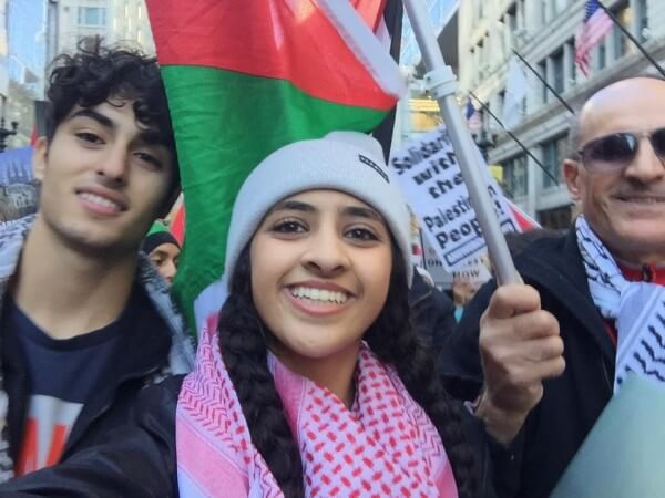 Protestors proudly wave Palestinian flags against Israeli injustice, demanding and end to the occupation. Protest in Chicago Sunday Oct. 18, 2015 against Israel's occupation. Photo courtesy of Dr. Atiyeh Salem