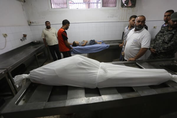 The body of Noor Hassan is prepared for burial at the Gaza mortuary after she was murderedby Israel's military during airstrikes targeting civilian areas early Sunday morning Oct. 11, 2015. The body of 4 year old Rahaf Hassan is prepared for burial in a Gaza Mortuary. Rahaf was murdered along with her mother, and her mother's unborn baby by an Israeli military terrorist airstrike against civilian targets in Zeitoun, Gaza Strip early Sunday morning, Oct. 11, 2015. Copyright (C) 2015 Mohammed Asad. All Rights Reserved.