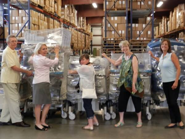 Drink leads volunteers with the medical equipment Abraham's Children has raised with the support of the First Presbyterian Church of Wheaton