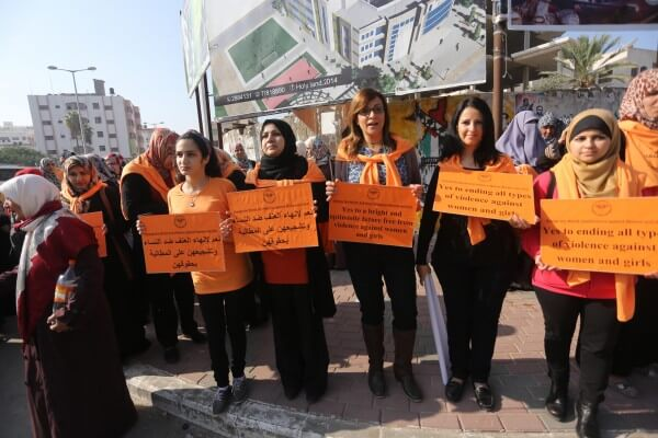 Women form a human chain outside the UN offices in the Gaza Strip to protest Israeli violence against women on the International Day Against Violence Against Women. Copyright (C) 2015 Mohammed Asad. All Rights reserved. Photos may be reproduced with proper credit to Mohammed Asad and the Arab Daily News