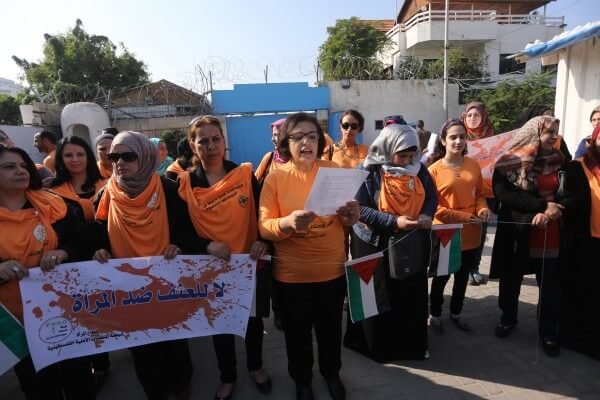 Gaza women protest violence. Copyright (C) 2015 Mohammed Asad. All Rights reserved. Photos may be reproduced with proper credit to Mohammed Asad and the Arab Daily News