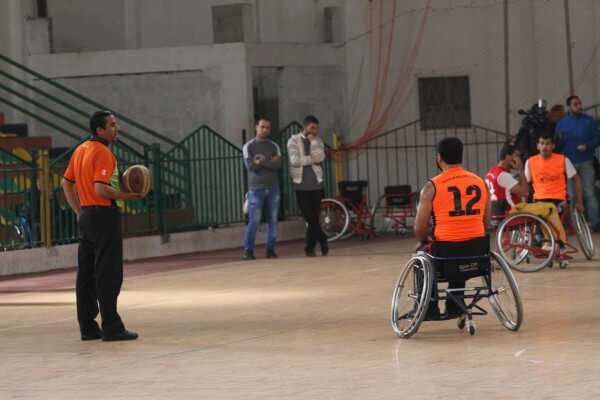 Disabled Palestinians compete in Basketball tournament. Copyright (C) 2015 Mohammed Asad. All Rights reserved. Photos may be reproduced with proper credit to Mohammed Asad and the Arab Daily News