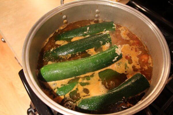 stuffed zucchini atop stew, Mediterranean recipe