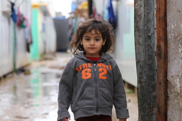 Palestinian child during storm in Gaza. Storm hits Gaza Strip in Palestine. Copyright (C) 2016 Mohammed Asad. All Rights reserved. Photos may be reproduced with proper credit to Mohammed Asad and the Arab Daily News