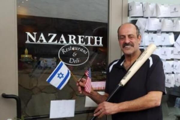 Christian Palestinian Israeli Hany J. Baransi in front of his Deli in Ghanna, Ohio, near Columbus that was the scene of a brutal machette attack in February 2016. (Photo from the Facebook Page of Hany J. Baransi)
