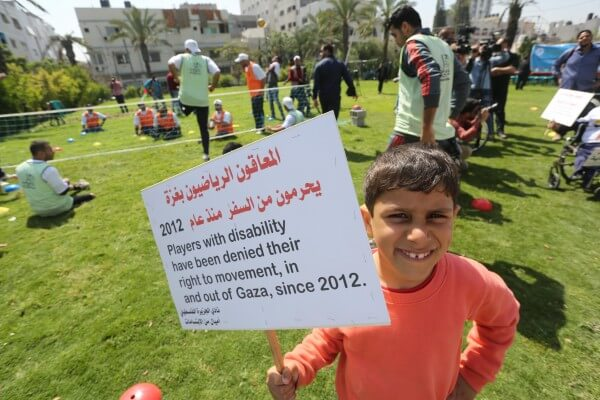 Palestinians support Gaza's wounded olympians during a paralympic commemoration in the Gaza Strip. Copyright (C) 2016 Mohammed Asad. All Rights reserved. Photos may be reproduced with proper credit to Mohammed Asad and the Arab Daily News