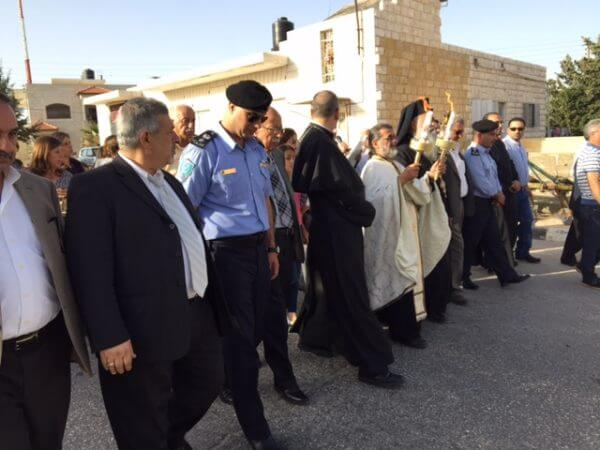 Fr Daoud Khoury receiving the Miracle of Holy Fire in Taybeh with church and civic leaders