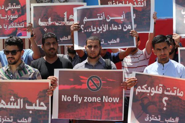 Syrian refugees in the Gaza Strip protest against the Syrian government and call for change. Copyright Mohammed Asad 2016. All Rights Reserved