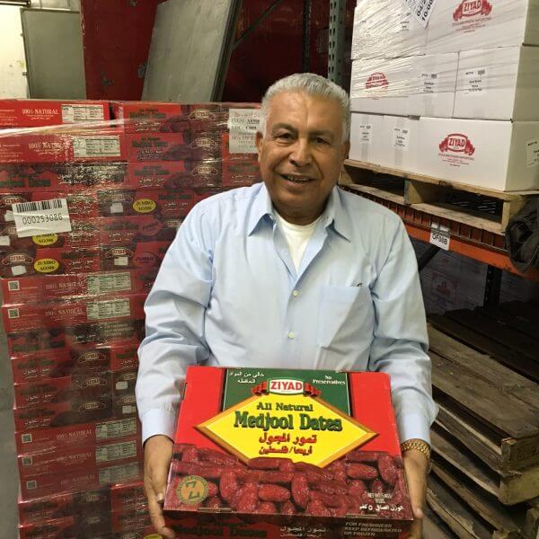 Medjool Dates packagaed by Ziyad Brothers Importing. here Ziyad owner Ibrahim Ziyad holds up one of the recognizable bright red Medjool Date boxes.