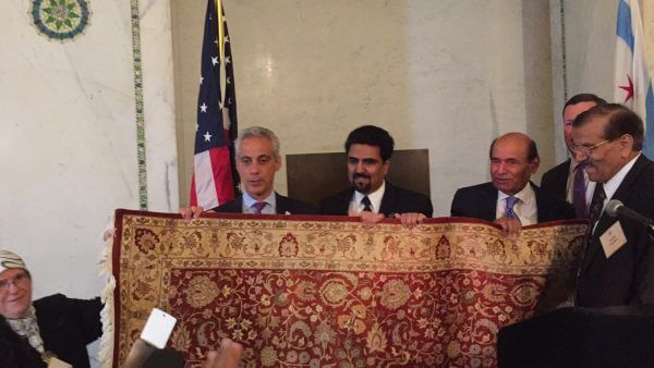 Chicago Mayor Rahm Emanuel accepts gift from host of Iftar dinner at the Chicago Cultural Center Tuesday June 28, 2016