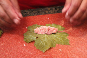 Wrapping a grape leaf (Lif Wariq duwally)