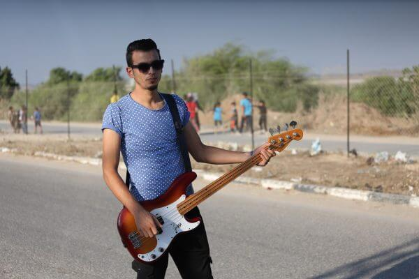 Palestinian band Dawaween, who were denied access to perform at a festival in Jerusalem, deliver a performance as part of a protest against the denial in Beit Hanun, near the Erez crossing point with Israel, in the northern Gaza Strip on August 6, 2016. Photo by Mohammed Asad