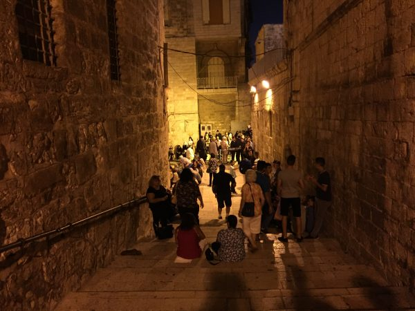 Thousands of people waiting at the break of dawn in the Old City to participate in annual traditional procession starting from the small monastery in front of the Holy Sepulchre Photo courtesy of Maria Khoury