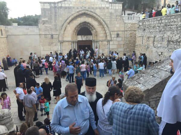 The Christian community in Jerusalem as we celebrated the century old traditions in honor for the Holy Mother of God. Thousand crowded the entrance to the Church of her Empty Tomb lighting candles all the way down descending the stairs into the crypt. This magnificent church was built in the 5th century and destroyed in the 7th century by Chosroes the Persian. Only the crypt of the church was preserved and the Crusaders erected the existing building over the crypt. Photo Courtesy of Maria Khoury