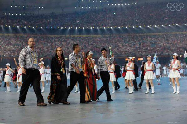 Palestine's Olympic team carries the Palestine flag at Sochi Olympics 2014. Photo courtesy of the International Olympic Committee (IOC)