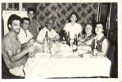 Arab family dinner table, 1950s. Photo Courtesy of the Ray Hanania Family Archive