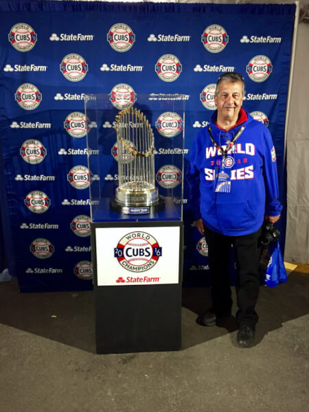 Fans at the 2017 Cubs Convention could pose with the World Series Trophy. Photo courtesy Ray Hanania. Permission granted to republish with full attribution